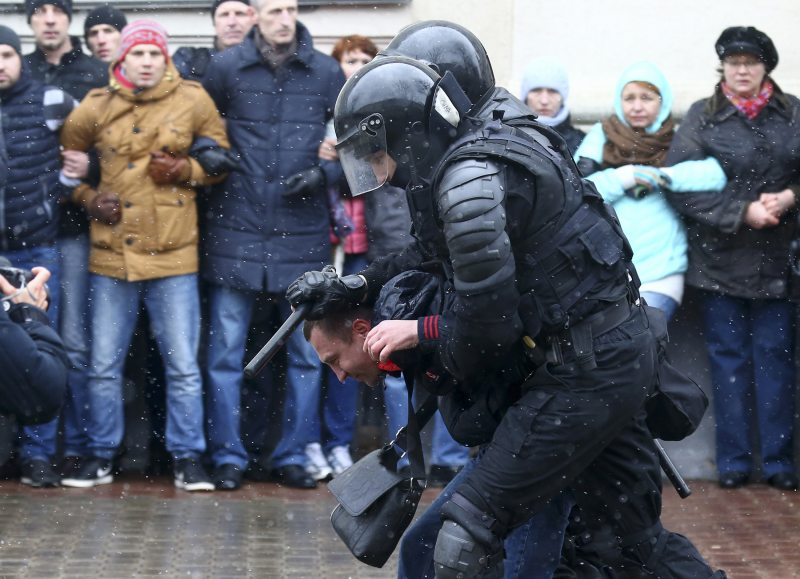 Riot police detain a man during a rally in Minsk on March 25.  © 2017 Vasily Fedosenko/Reuters