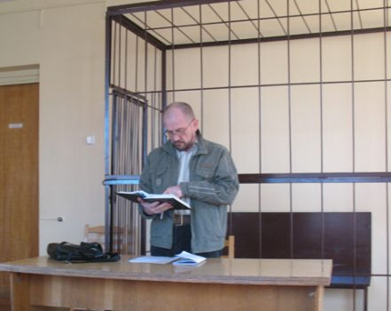 Uladzimir Hundar reads from the Bible about the justice of judges