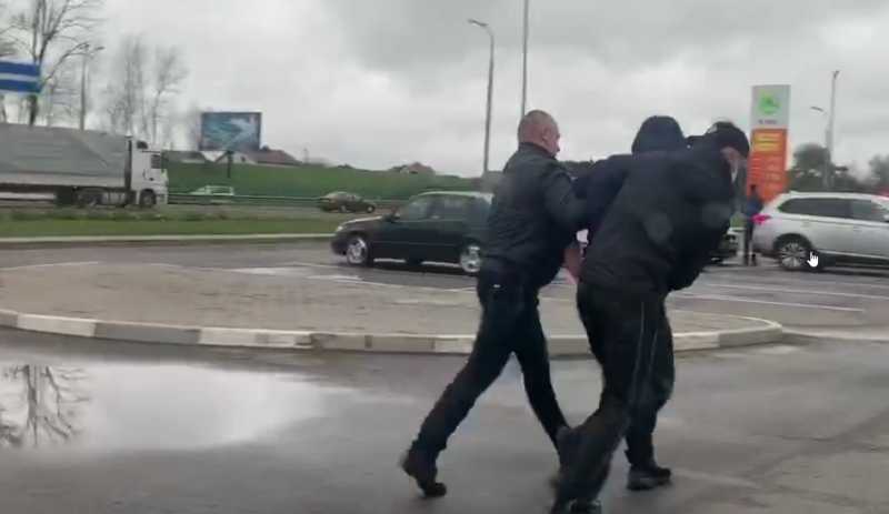 Police officers arrest protester on May 6, 2020 in Minsk