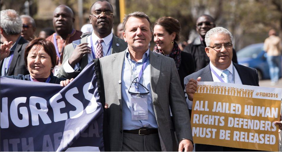 Dimitris Christopoulos (center) during the March for Human Rights at FIDH's 39th Congress in Johannesburg