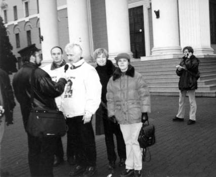 """Viasna"" activists during a protest against politically-motivated disappearances outside the KGB Minsk office, 2000. Left to right: Valiantsin Stefanovich, Ales Bialiatski, Tatsiana Reviaka, Alena Laptsionak"